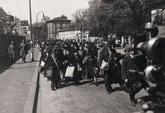 25 April 1942, Jews being marched through the streets of Würzburg to the train station, en route to their deportation.Yad Vashem Photo Archives 7900/53