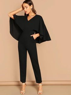 Shein V-Neck Solid Cape Jumpsuit - V-Neck Jumpsuit - Ideas of V-Neck Jumpsuit - Shop V-Neck Solid Cape Jumpsuit online. SheIn offers V-Neck Solid Cape Jumpsuit & more to fit your fashionable needs. Cape Jumpsuit, Bodycon Jumpsuit, Jumpsuit Outfit, Jumpsuit Hijab, Gold Jumpsuit, Strapless Jumpsuit, Hijab Fashion, Fashion Outfits, Womens Fashion