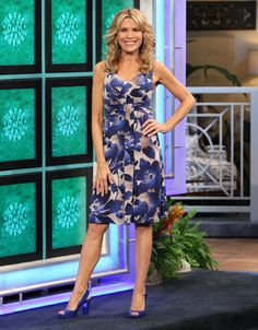 TOMMY BAHAMA: Poppy Cross dress w/abstract blue floral print in tan background, v-neckline, sleeveless, horizontally shirred midriff w/vertical drape CF | Vanna White's dresses | Wheel of Fortune
