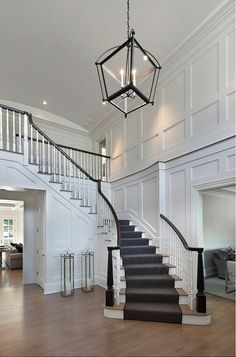 Floor to ceiling recessed paneling adds elegance to this spacious two-story entry foyer with barrel vaulted ceiling.