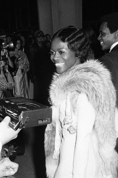 """Cicely Tyson answers a reporters questions on the red carpet as she arrives at the #Oscars on March 27, 1973. Ms. Tyson was nominated in the Best Actress category for her role in the film, Sounder"""". She and Diana Ross made history that year as the first Black actresses nominated in the Best Actress category in the same year. Photo: Frank Diernhammer/Conde Nast Archives."""