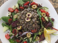 A salad recipe that fits the '5 piece puzzle' principle from my newest book S.A.S.S! Yourself Slim: organic greens, sliced grape tomatoes, cucumbers & red onion, cooked chilled red quinoa, a scoop of lentils, Mediterranean green and black olives, dressed with white balsamic vinegar, cracked black pepper and fresh squeezed lemon.