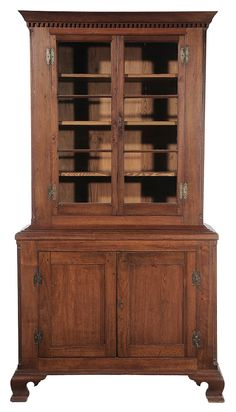 Southern Chippendale Walnut Press Cupboard - Virginia or North Carolina, late 18th/early 19th century, upper case with glazed doors flanked by quarter columns, dentil-molded cornice, lower case with paneled doors, quarter columns and ogee bracket feet, rosehead nail construction, 87-1/2 x 49 x 15 in.