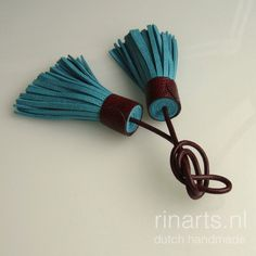Turquoise double tassel bag charm with burgundy red ostrich leather top