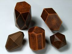 A small group of very old pear wood crystal models measuring up to 2.8 inches tall.