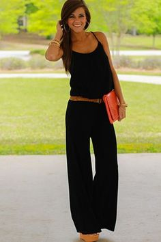 """This black one-piece is exactly what every fashionista's summer wardrobe NEEDS. Simple and elegant, this soft, pocketed jumpsuit can be taken from day to night! Don't miss out on this versatile number!:) Fits true to size. Miranda is wearing the small. Length from base of strap to bottom: S- 59"""" M- 59.5"""" L- 60"""