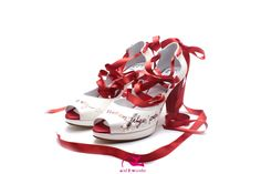 Custom made red and white shoe open toe with satin ribbons and drawings.