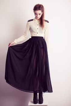 high waisted black skirt, white buttoned top with shoulder detail