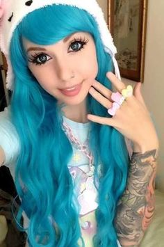 Alexa Poletti! Now I know she's known for wearing wigs, but I LOVE her sleeve! I wanted one til I got symmetrical tats on my forearms LOL