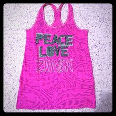 Zumba tank Zumba tank. Preloved. Visible pilling from normal wear. Priced accordingly. Bundle to save more! No trades please. Zumba Tops Tank Tops