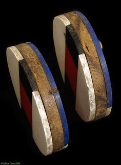 Africa | Detail from a pair of old Earplugs ~ Isizhaza Amashaza ~ from the Zulu people of South Africa | Marlet titles, wood and glue | ca. 1950s:
