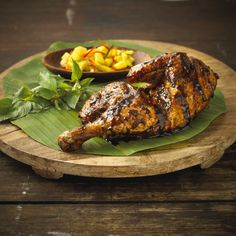 Enjoy the succulent taste of Indonesian roast chicken with a burst of other flavours served on a banana leaf platter that adds a zing to your taste buds.