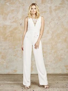 An injection of stunning, beaded French bridal lace in this bridal jumpsuit Elegance has Evolved www.houseofollichon.co.uk