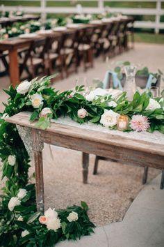 Gorgeous Garden Inspired Sweetheart Table Garland  See more here: http://www.cedarwoodweddings.com/2014/08/gracious-garden-wedding-allyssawesley/