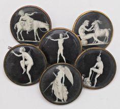 Attribué à Jacques Joseph De GAULT (1738 - mort après 1812)  Suite de six gros boutons de la fin du XVIIIe siècle, ornés de miniatures en grisaille sur ivoire, représentant faune, nymphe, silène, génie ailé, faune et bouc Diam. de chacun: 4 cm