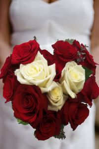 this heart themed wedding bouquet is heart not to miss!. red and white roses shaped in a heart make it a perfect bridal bouquet. Heart Not To Miss by Enchanted Florist in Taos, New Mexico. http://www.taosflorist.com/weddings/taos-wedding-flowers/