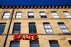 Salts Mill, Saltaire near Bradford, England. One of the coolest, most unique and atmospheric retail environments/gallery spaces anywhere.