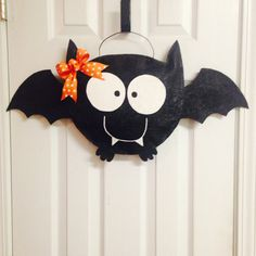 This cute bat burlap door hanger measures 25 x14. It is hand painted on both sides and sprayed with acrylic sealant to withstand the