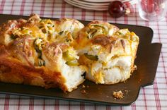 Mexican Monkey Bread recipe  1can  (16.3 oz.) refrigerated biscuits, quartered, divided  2Tbsp.  butter, melted  1-1/4cups  KRAFT Shredded Cheddar Cheese, divided  3/4cup  drained canned sliced jalapeño peppers, divided  3/4tsp.  parsley flakes, divided  1/4cup  KRAFT Shredded Mozzarella Cheese