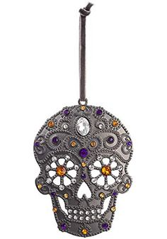 This is a Spooky Sugar Skull Ornament. - Ornament Product Features Size: Standard Metal Ornament Cutout skull Jewels placed for that sugar skull look Ribbon at the top for hanging Halloween Ornaments, Christmas Ornaments, Spooky Decor, Christopher Radko, List Of Artists, Holiday Tree, All Brands, Sugar Skull, Branding Design