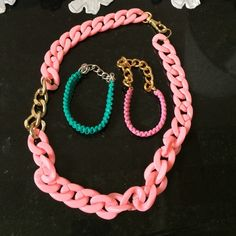 Set of necklace and bracelets. Pink plastic chain necklace with a section of gold chain. Two bracelets. One pink and one green with chain. Great condition. etsy Jewelry Necklaces