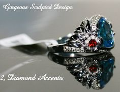 Our ( Brand New) version of an Art-Deco Inspired Ring and Mofiff. Deep Rich Swiss Blue AAA Gemstone, Rhodolite Garnets and White Diamonds Accent Stones. This Ring is Stunnin