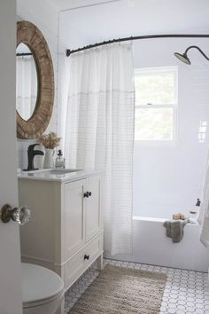 I love how this doesn't have a door and has a curved shower curtain rod More