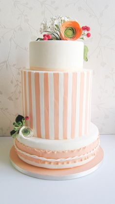 Striped peach and white wedding cake.
