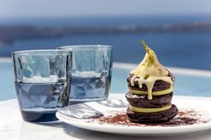 Chocolate pancakes served with pear and dulce de leche at Grace Santorini.
