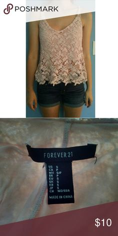 Tank top It's light pink with lace, super cute and comfy! Forever 21 Tops Tank Tops