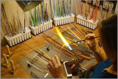 A window in to the creation of Lampworking.. What an amazingly organized torch bench!