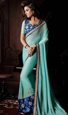 Design and trend will be at the peak of your magnificence once you attire this pale cyan blue faux georgette saree. The lace, resham, stones work on dress personifies the complete look. #EarthlyBlueShadesOfDesignerSari