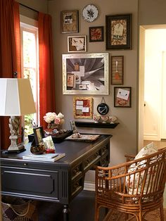 Here, a cozy corner in the living room serves as a family's home office. The charming corner office uses elements found around the house to maximize its storage and style potential. On the walls, fabric-covered pin boards add color and display space for photos, lists, and notes. Borrowed bowls, tumblers, and silverware surround the space, holding thumbtacks, paper clips, pens, and more.