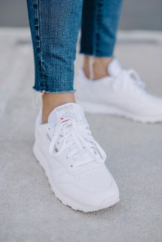 Check out all these ways to style Reebok classics. From pairing classic Reeboks with skirts, dresses and trench coats, there's a way to wear these street style sneakers for any casual personal style. All White Sneakers, White Reebok, Sneakers Mode, Womens White Sneakers, Men Sneakers, White Sneakers Outfit Spring, All White Shoes, White Shoes Outfit