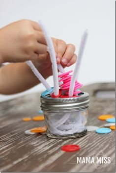 fine motor: Portable Button Play   @mamamissblog #finemotor #buttons #playmatters