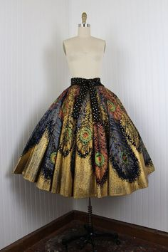 This is an exquisitely detailed 50s skirt. Peacock designed fabric looks lovely on this vintage circle skirt.