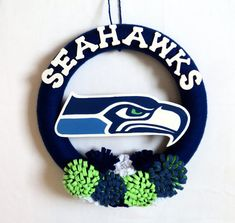 Show your neighbors and guests who you root for by proudly displaying this beautiful handcrafted Seattle Seahawks wreath on your front door.