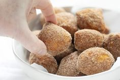 Deep-fried dough is covered in a cinnamon and sugar mixture in this easy to make and even easier to eat Easy Donut Bites recipe. Fun Baking Recipes, Donut Recipes, Fudge Recipes, Bread Recipes, Donut Bites Recipe, Bakers Sweets, Apple Spice Cake, Chocolate Peanut Butter Fudge, Flaky Biscuits