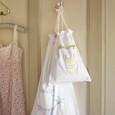 White cotton bags hanging on a door hook