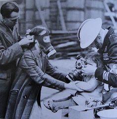Fitting children with gas masks. U.K. WW2
