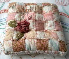Pretty Patchwork Pincushion with Butterflies and Pearls.