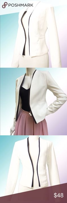 White Layered Mango Blazer Super cute white blazer with inner black layer detail around the neck and lapel. Blazer is lined! Our fave piece because it can be taken from day to evening, office to dinner, and worn with jeans, slacks, skirts and matches a variety of colors! Available in sizes S, M, L but limited in stock! Also available in black and more blazers coming soon! Shop The Aivy's Closet for young, professional, fashionable and affordable attire! Mango Jackets & Coats Blazers