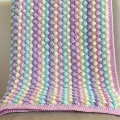 Crochet bobble blanket in Cream, Sherbet, Wisteria and Clematis Stylecraft acrylic yarn. Measures approximately 32 inch square. Crochet baby blanket - easy, quick and pretty! No pattern but does have a chart and it doesn& look to hard. Crochet Bobble Blanket, Crochet Blanket Patterns, Crochet Stitches, Knitting Patterns, Crochet Blankets, Diy Crochet, Crochet Crafts, Crochet Projects, Diy Crafts