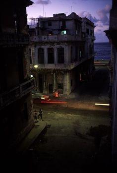 David Alan Harvey CUBA. Havana. 1998. A central Havana street at dusk.
