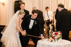 Quite the exciting cake cutting!   Julia Archibald Wedding Photography