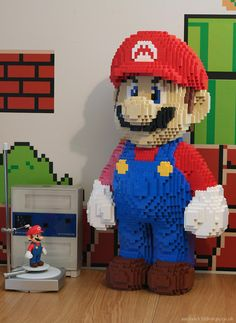 Ever wanted a giant LEGO model of Mario from Super Mario Bros? Well, Keith Brogan of the Luxology forums did, so he made one. Original Mario statue being s… Lego Mario, Lego Super Mario, Mario Bros., Lego Design, Deco Lego, 3d Scanner, Lego Sculptures, Nintendo, 8bit Art
