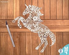 Printable PDF and SVG papercut template Unicorn with flowers , instant download. For personal and commercial use. -------------------------------------------------------------------------------------------------- Elephant SVG/PDF template for hand and machine cutting is also available! https://www.etsy.com/uk/listing/516586660/svg-pdf-papercut-template-elephant ------------------------------------------------------------------------------------------------...