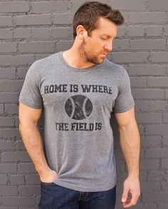 Men need to look stylish on GAMEDAY too. OurHome Is Where the Field Is® tee is now available FOR MEN too! Support your team in style this season, with our deep heather crew neck, super soft tee. Mix in your team's primary colors, such as a red belt or a blue hat, to complete your gameday ensemble. Ladies, if you just love this tee so much, order one size down (this tee uses men's sizing), and you wear it for a little bit sportier of a look!