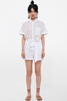 Short dress featuring a high neck, long sleeves with pronounced shoulders and cuffs, draped detail at the waist, asymmetric wrap-style hem and button-up fastening in the back. Zara Tops, Glossier Girl, Topshop Style, Cutwork Embroidery, White Jumpsuit, Zara Women, Mode Inspiration, Wrap Style, Piercing