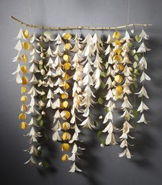 paper flower chains hung on a wooden stick.